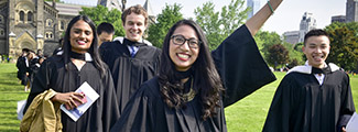 Excited graduates at U of T wearing grad gowns
