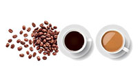 Two cups of coffee on a white table with coffee beans