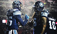 Two Toronto Argonauts meeting on the football field