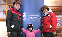 A family dressed in ski gear
