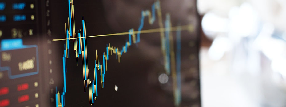 Photo of screen with fluctuating stock market graph