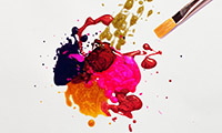 Splatter of colourful paint with a brush