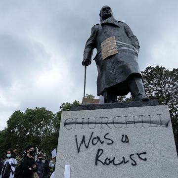 Statue to Churchill with graffiti, stating that he was a racist