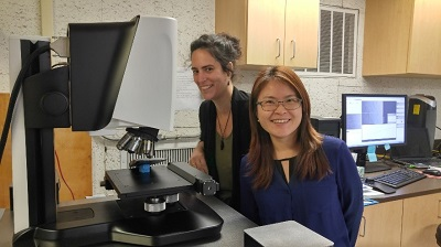 Liye Xie and Tiziana Gallo next to the Sensofar microscope