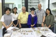 Gary Crawford and David Smith with research team at Fudan University.