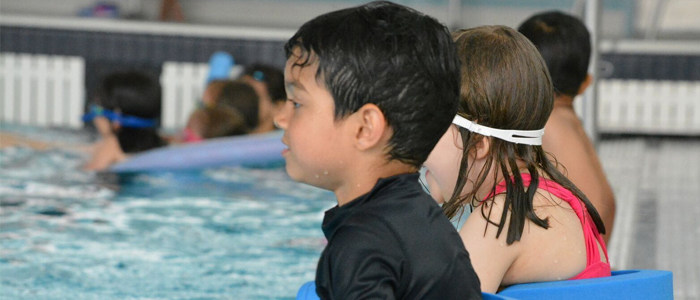 Children lined up for swimming lessons