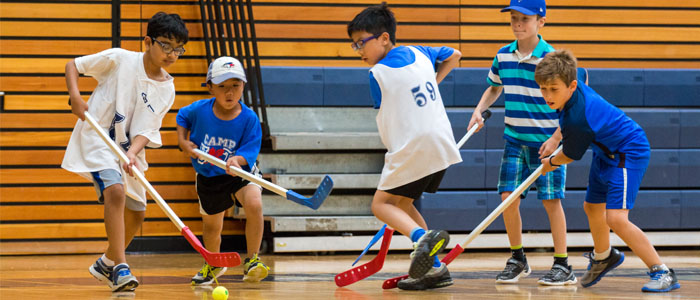 Campers playing hockey in Gym A