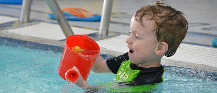 Pre-School Aquatics class playing with a watering can