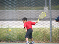 Racquet camp- Boy taking shot