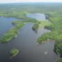 aerial view of forested land and water