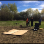 Ensminger lab launching a drone in a field