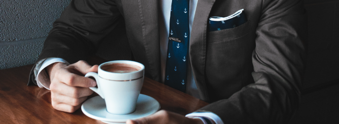 Host page for JSP, image of man in brown tweed suit sitting with a cup of coffee