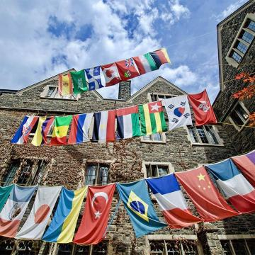 International flags fly outside Victoria College residence.