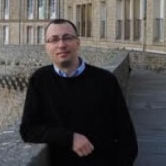 professor gueorgui kambourov outside building