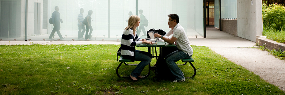 Students chatting on a picnic bench