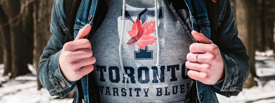 A student wearing a U of T sweatshirt