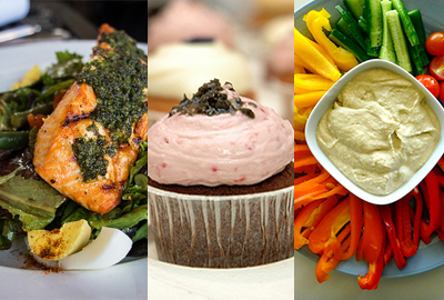 Photo of Salmon on a salad, cupcakes and vegetables with dip