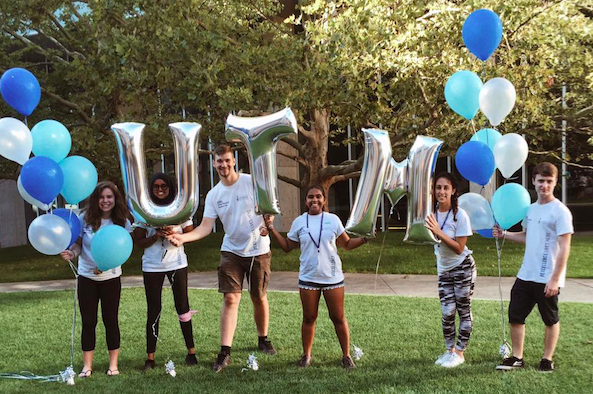 Residence Student Staff members with balloons that read UTM