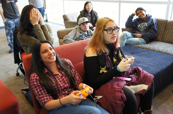 Students playing video games in the common room