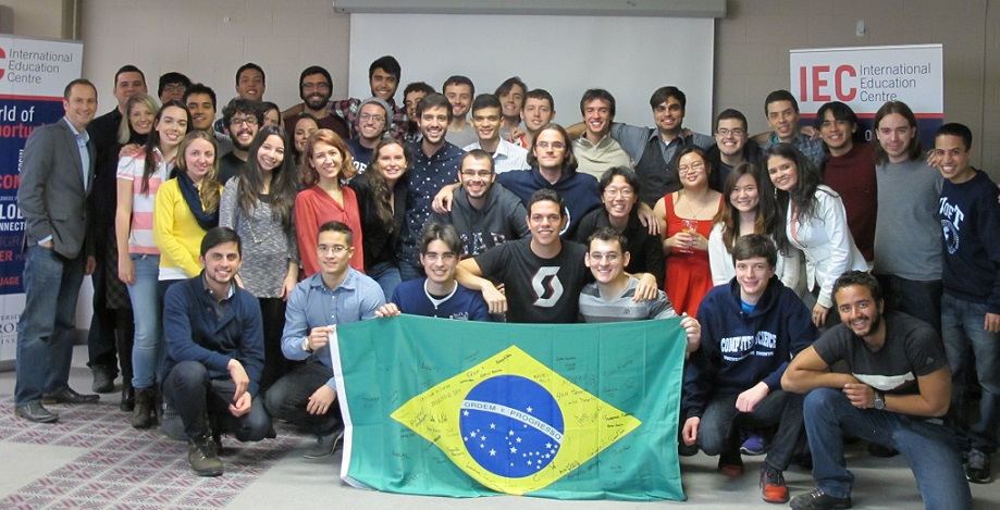 Group of students standing behind a Brazilian flag