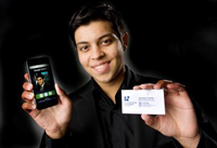 UTM Student holding cell phone and business card