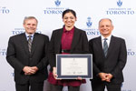 Sarah Adnan poses with Gordon Cressy and U of T president Meric Gertler