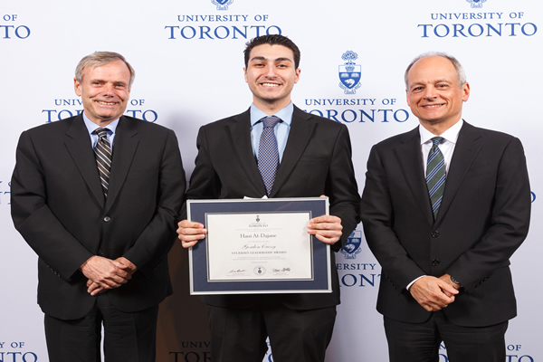 Hani Al-Dajane, 2014 Gordon Cressy Award recipient poses with Gordon Cressy and U of T President Meric Gertler