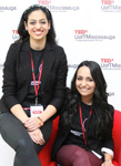 Image of Sarah Adnan and Sarah Israr sitting on a red arm chair at TEDx event