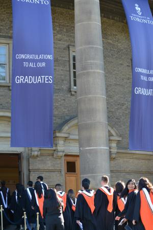 Graduands walk towards Convocation Hall