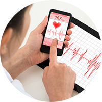 Doctor pointing at heartrate on phone