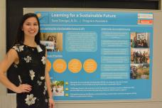 MScSM student standing next to research poster