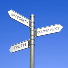 Image of signpost with words integrity, truth and commitment