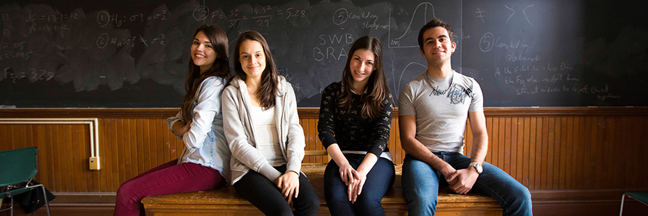Students smiling in a classroom at U of T
