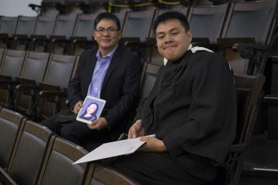 Bill Bin Yang and his son Tony Yuhao Yang at Convocation Hall on June 7, 2017. They brought a photo of Tony's mom, Anna Hongtao Jiang, who died of cancer last year