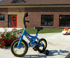 Image of bike in front of child care centre