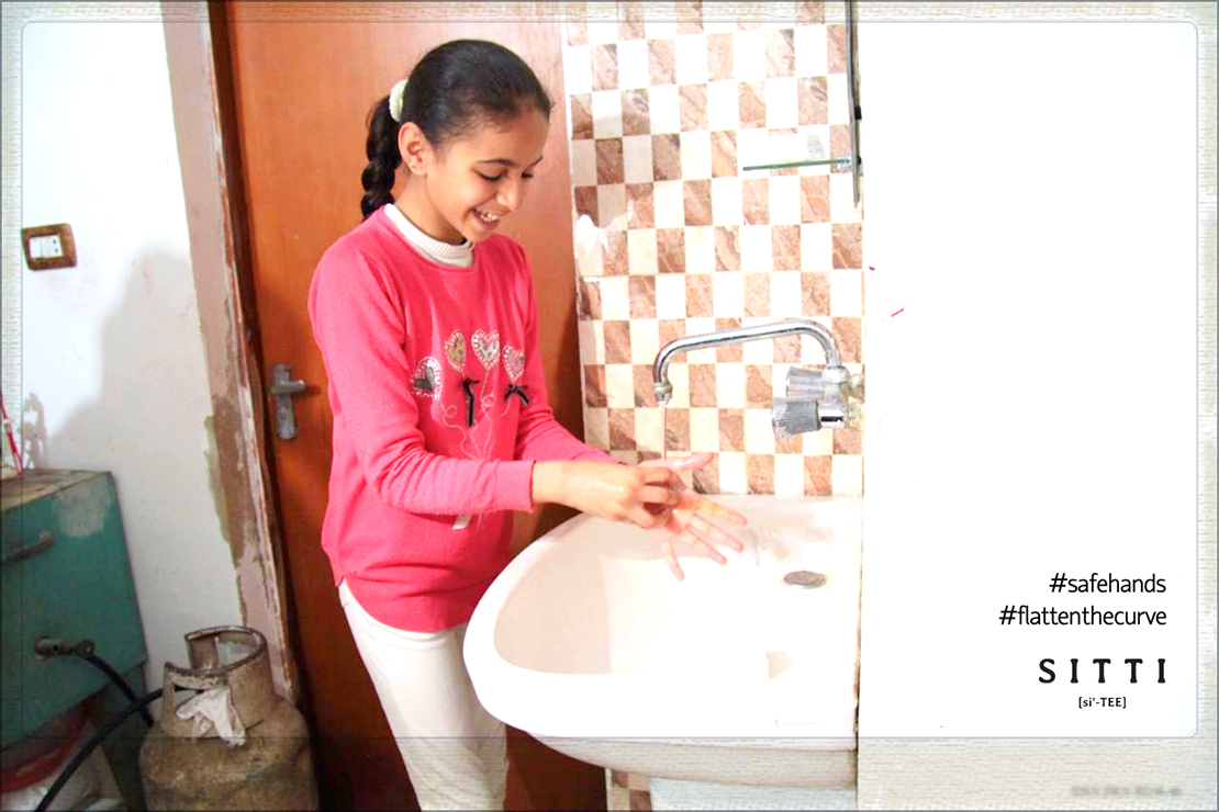 Girl washing hands with text #safehands and #flattenthecurve
