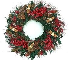 Green wreath with red berries on a white background