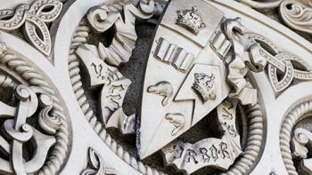 stone carved with U of T crest