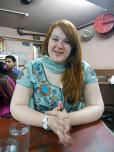 Kristin Plys in a coffeeshop in India, wearing a sari