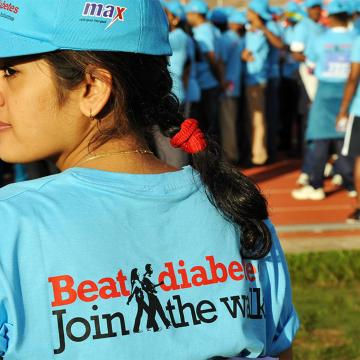 Woman wearing t-shirt that reads Beat Diabetes, Join the walk