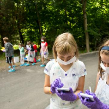 Children at wearing protective gloves and masks