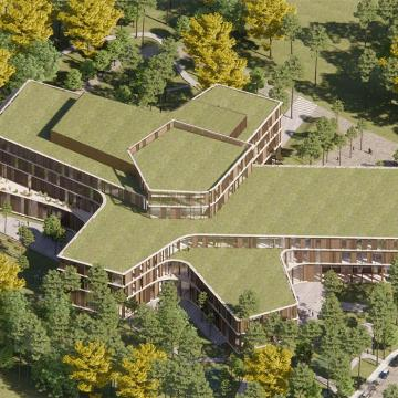 Overhead image of building with green roof, building has five spokes coming out from centre and is about 5 storeys tall at its highest point.