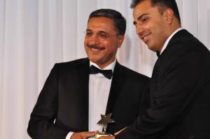 Deep Saini accepts an award