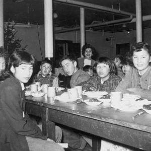 Indigenous children at a dining table in a residential school