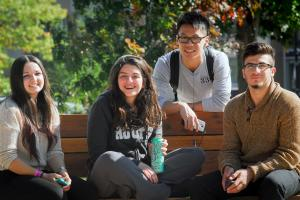 Four students by bench