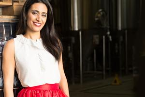 Manjit Minhas in a white shirt and red skirt