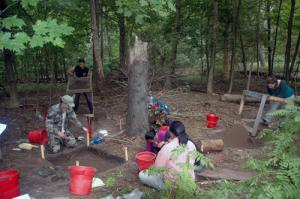 Students in UTM's historical archaeology field school course excavate near Lislehurst