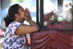 A woman prays at St. Sebastian's Church in Negombo on April 22, a day after the building was hit as part of a series of bomb blasts targeting churches and luxury hotels in Sri Lanka