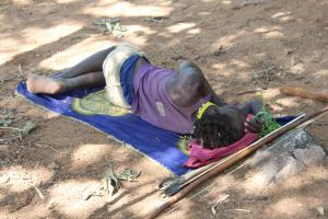 Hadza man sleeping on ground