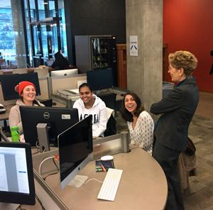 Wynne at library talking to three female students